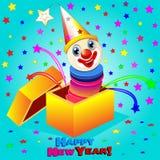 快活的小丑跳出箱子 免版税库存图片