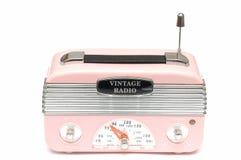 怀乡时代的一台现代设计桃红色收音机 免版税图库摄影