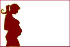 怀孕的剪影 免版税库存图片