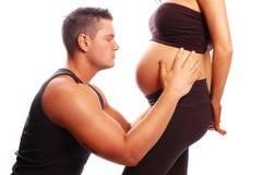 怀孕的夫人和人 免版税库存照片