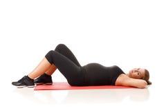 怀孕的瑜伽 免版税图库摄影
