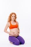 怀孕的瑜伽 库存照片