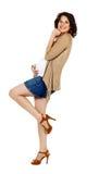 怀孕的短裤妇女 免版税库存图片