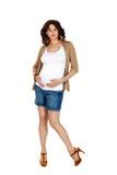 怀孕的短裤妇女 免版税库存照片