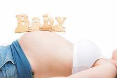 怀孕的腹部 免版税库存图片