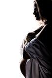 怀孕的配置文件妇女 免版税库存照片