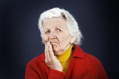 怀疑老年长妇女 免版税库存照片