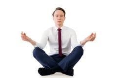 思考在瑜伽姿势的禅宗商人 免版税库存图片