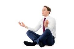 思考在瑜伽姿势的禅宗商人 库存照片
