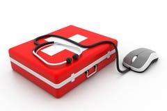 急救工具和计算机老鼠 免版税库存照片