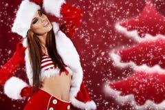 性感圣诞节的女孩 免版税库存照片