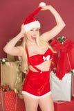 性感女性圣诞老人微笑 库存图片