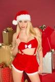 性感女性圣诞老人微笑 库存照片