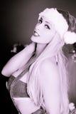 性感女性圣诞老人微笑 免版税库存图片
