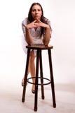 性感椅子的护士 免版税库存图片