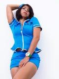 性感的亚裔女服空服员制服 免版税库存照片