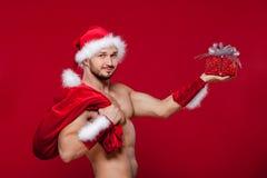 性感的圣诞老人有您的惊奇 库存图片