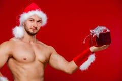 性感的圣诞老人有您的惊奇 库存照片