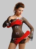 性感的女孩关闭了用在红色手套的奇怪的手 免版税库存照片