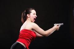 性感的少妇-开枪在黑背景 库存图片
