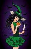 性感的巫婆和刀片,万圣夜卡片 免版税库存照片