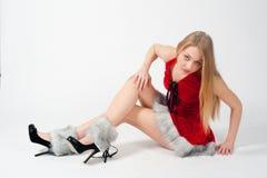 性感的年轻白肤金发的妇女喜欢圣诞老人 库存图片