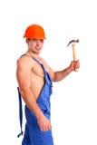 性感的技工画象有锤子的 免版税库存照片
