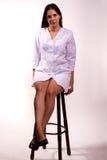 性感的护士坐椅子 免版税库存照片