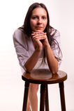 性感的护士坐椅子 库存图片