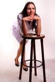性感的护士坐椅子 免版税图库摄影