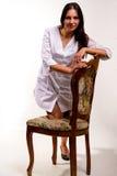 性感的护士坐椅子 库存照片