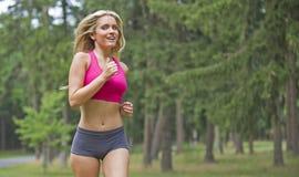 性感的新白肤金发的妇女-跑步 库存照片