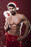 性感的男性圣诞老人 免版税库存照片
