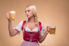 年轻性感的白肤金发的佩带的少女装 免版税库存图片