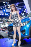 性感的礼服的赠送者在2013年12月3日的第30泰国国际马达商展在曼谷,泰国 免版税图库摄影