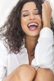 性感的肉欲的笑的愉快的妇女在Ecstacy 免版税库存图片