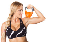 年轻性感的被隔绝的健身式样藏品橙色kettlebell 库存图片