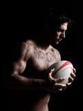 性感的露胸部的橄榄球人画象 图库摄影
