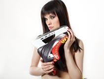 性感的滑冰的妇女 免版税库存图片