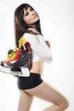 性感的滑冰的妇女 免版税库存照片