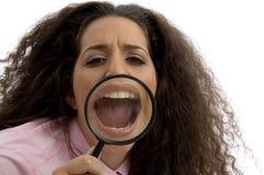 总公司被扩大化的嘴妇女年轻人 库存图片