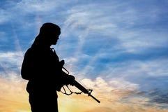 恐怖分子的剪影 免版税库存照片