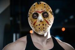 恐怖残酷贾森面具人坚强的爱好健美者运动健身 库存照片