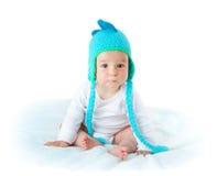 恐龙帽子的婴孩 免版税库存图片