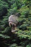 恐龙雕塑在公园 免版税库存图片