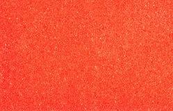 巴恩海绵特写镜头,红色抽象有孔背景 图库摄影