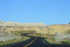 恶地国家公园弯曲的路在一个晴天 免版税库存图片