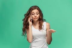 恶心的妇女画象有手机的 库存图片