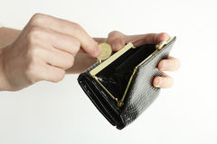恶意嘘声和硬币在手上 免版税库存照片