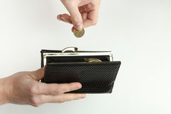 恶意嘘声和硬币在手上 免版税图库摄影